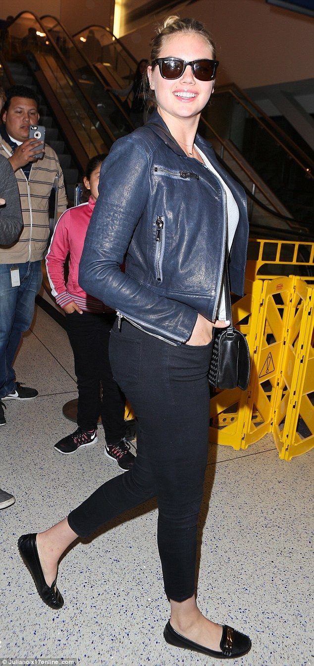 City chic: The 23-year-old star rocked a dark blue leather jacket and cropped denim jeans ...