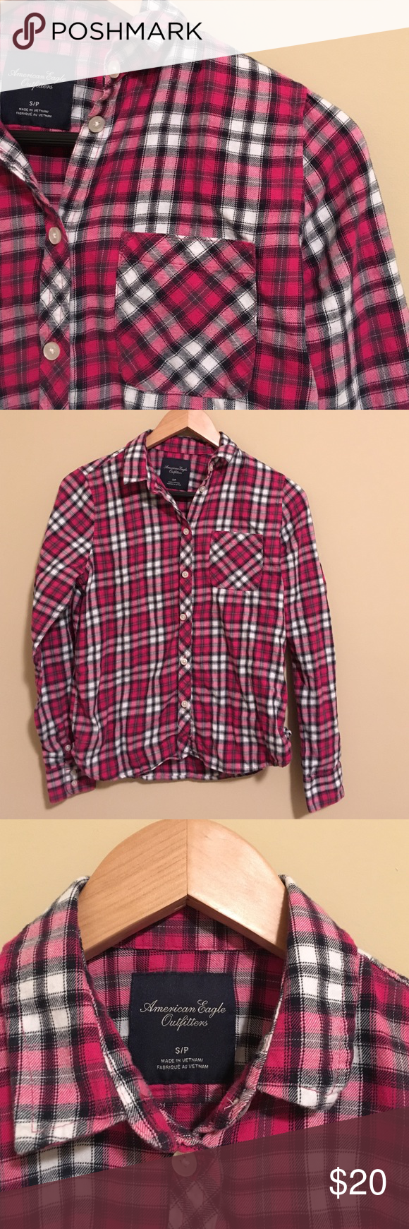 American Eagle Flannel Pink, black & white plaid flannel from American Eagle. Super cute & soft, looks great with a black vest! No holes or stains, make an offer! American Eagle Outfitters Tops Button Down Shirts