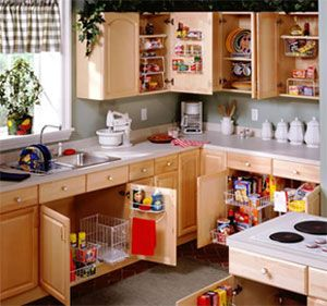 wire pullout drawers in the kitchen cabinets help keep things