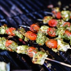 Chicken and cherry tomatoes brushed with zesty pesto is the perfect summery dish.