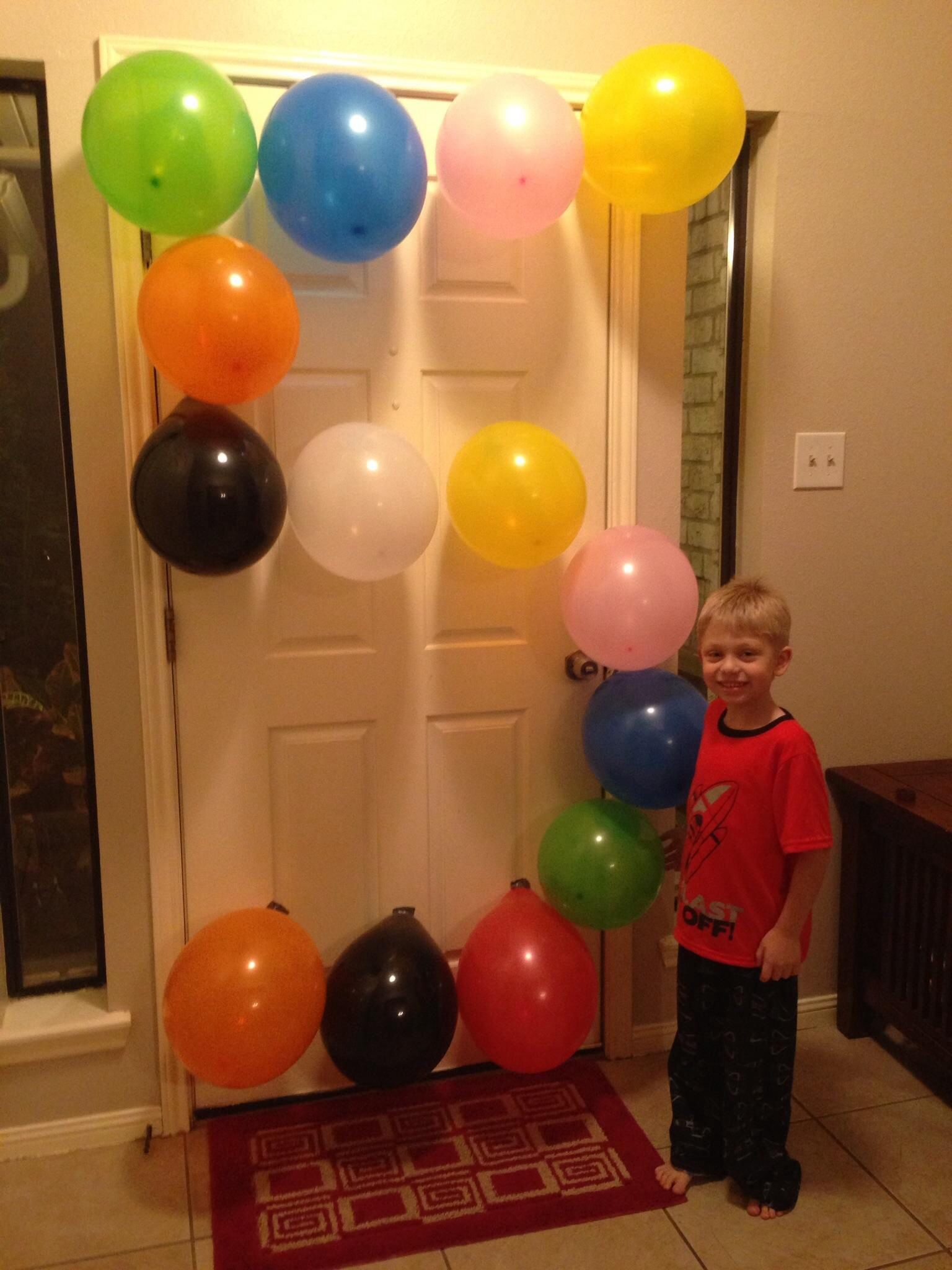 Son Turned 5 Years Old Take A Picture With Balloons Shaped Into The Number