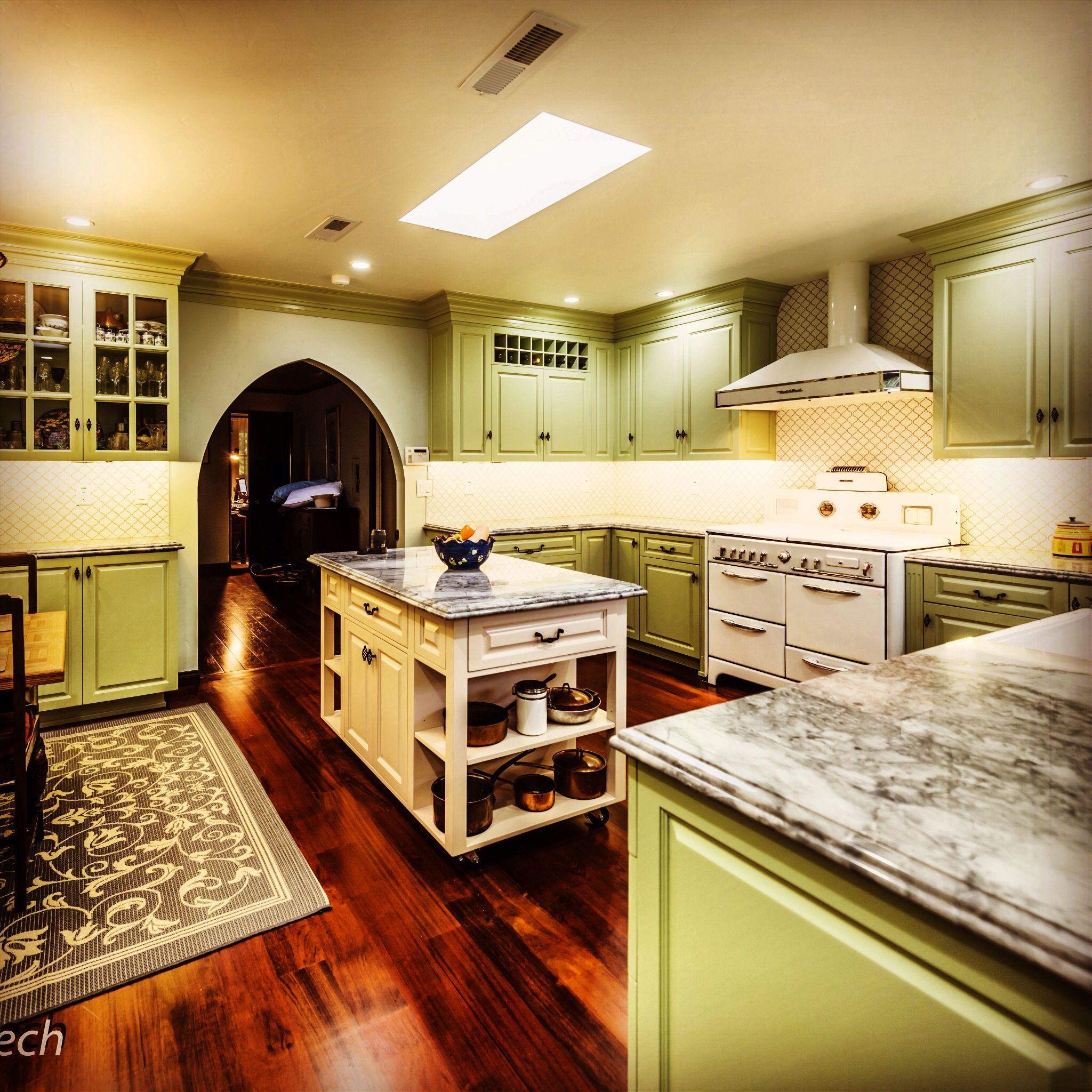 Retro Farmhouse Kitchen With Spanish Moorish Moroccan Tiles On The Walls And Vintage Refurbished Stove