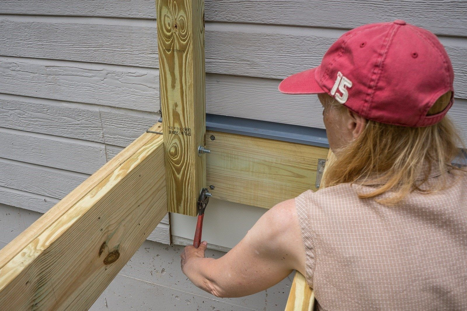 Attaching deck to house with siding - Step By Step Instructions For Installing Deck Rail Posts To Your Deck Frame
