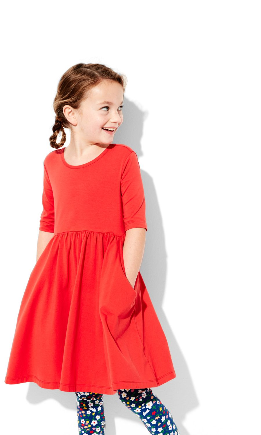 Happiness in a dress...supersoft and comfy stretch cotton twirls as easily as it washes, with wear-it-every-day durability.  •Cotton/spandex stretch jersey  •Fitted bodice with full skirt  •Elbow length sleeves  •Pockets  •Scoopback neckline