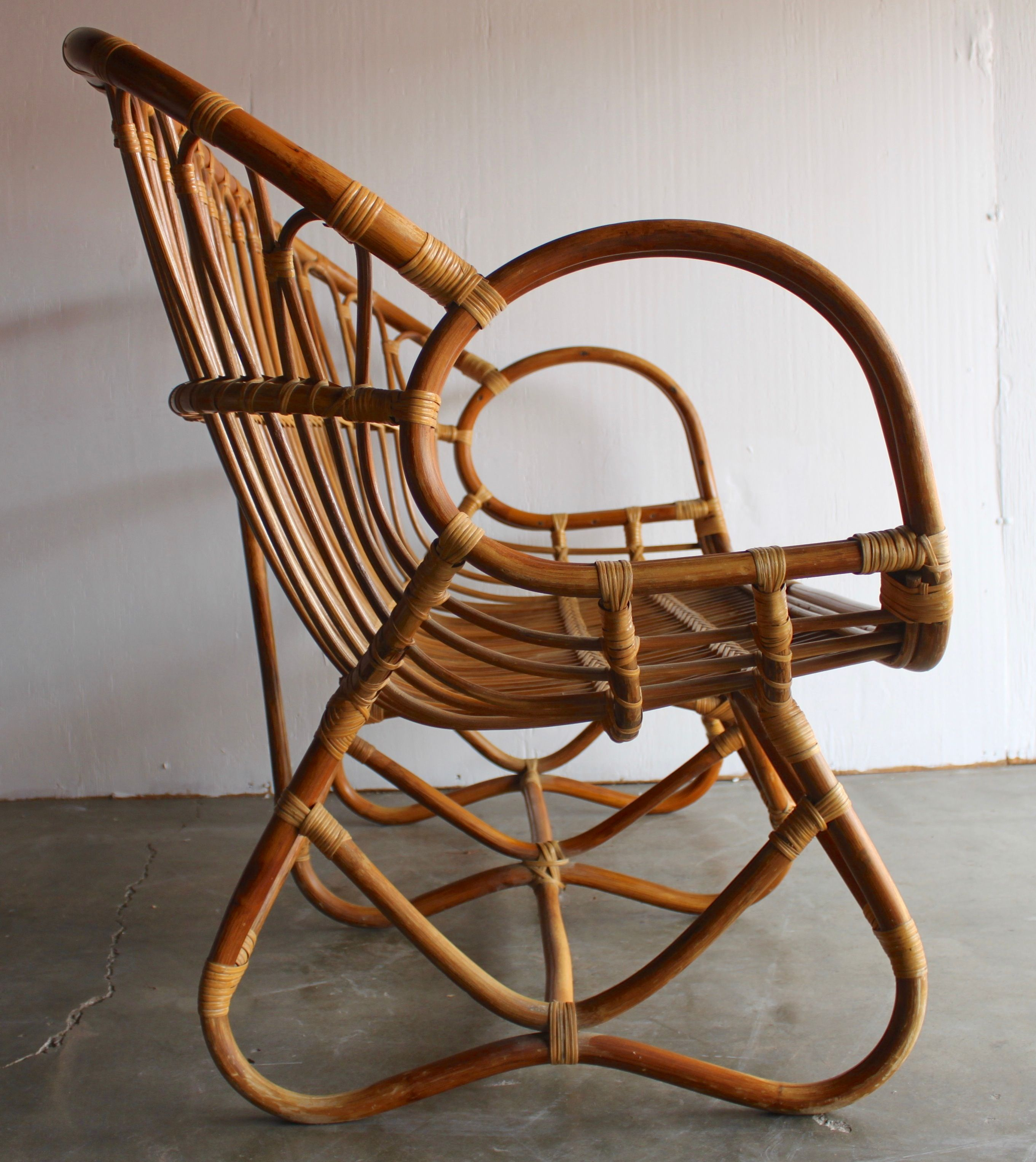 """Very desirable, sculptural bamboo and rattan settee/love seat attributed to Franco Albini.  Beautifully constructed, well-built piece with remarkable craftsmanship.  Exceptional condition with extremely minor surface wear.  No breaks or damage to caning and rattan.   51"""" long, 27"""" deep, 36"""" back height, arm height 28"""", seat height 16""""Free local pick up in San Diego.  Affordable private delivery to LA/Palm Springs and surrounding, please inquire.  Fre..."""