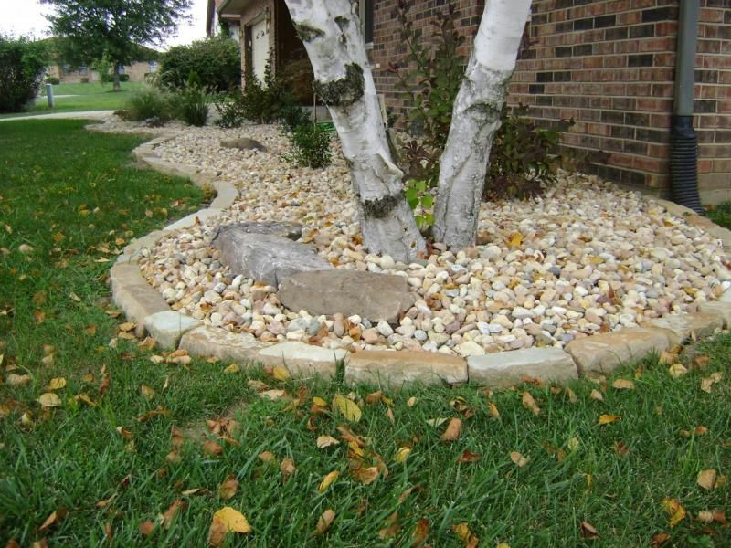 weilbacher landscaping installation of mulch decorative rock trees shrubs berms bed