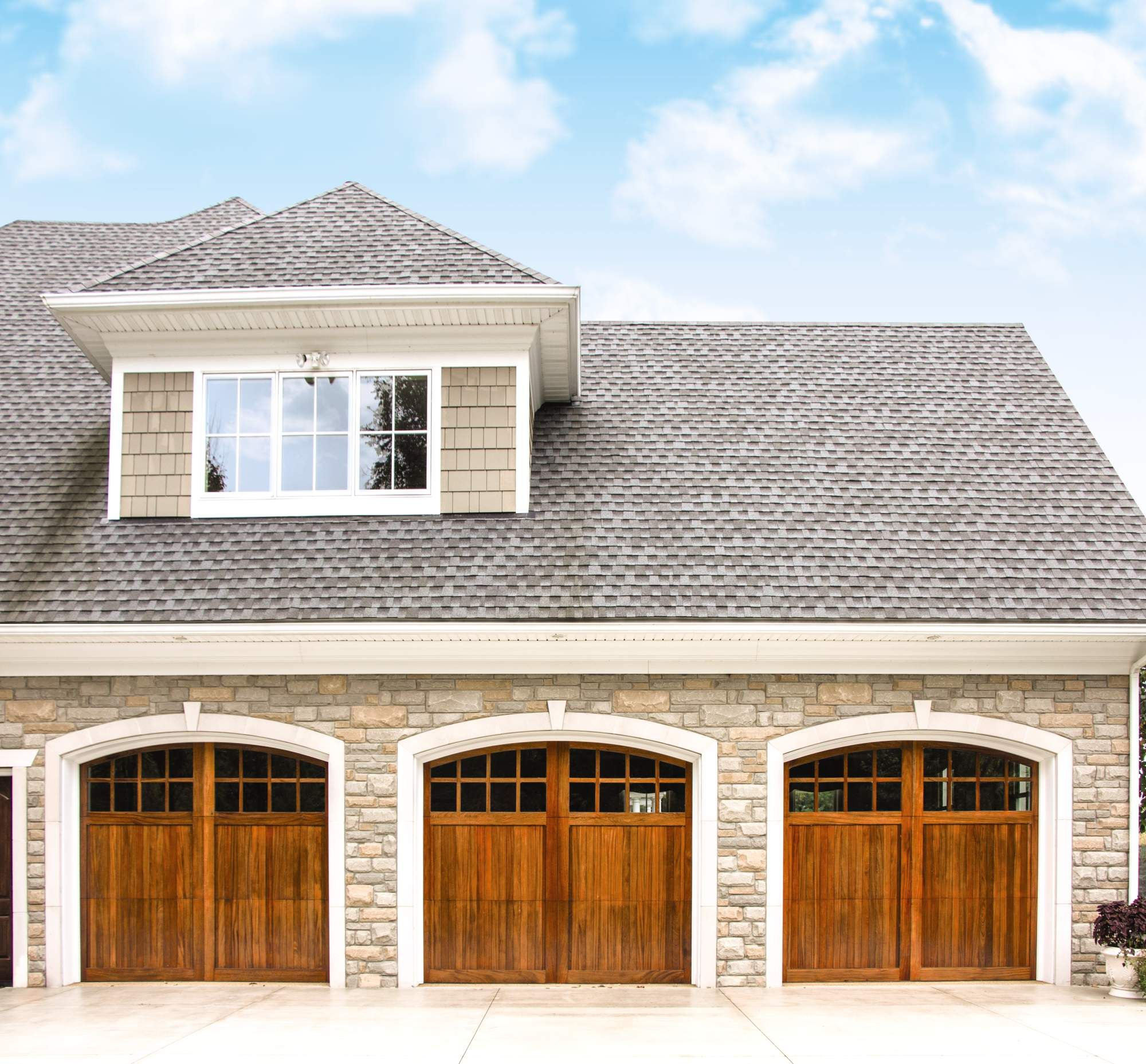 Custom wood garage door series African Mahogany Exterior