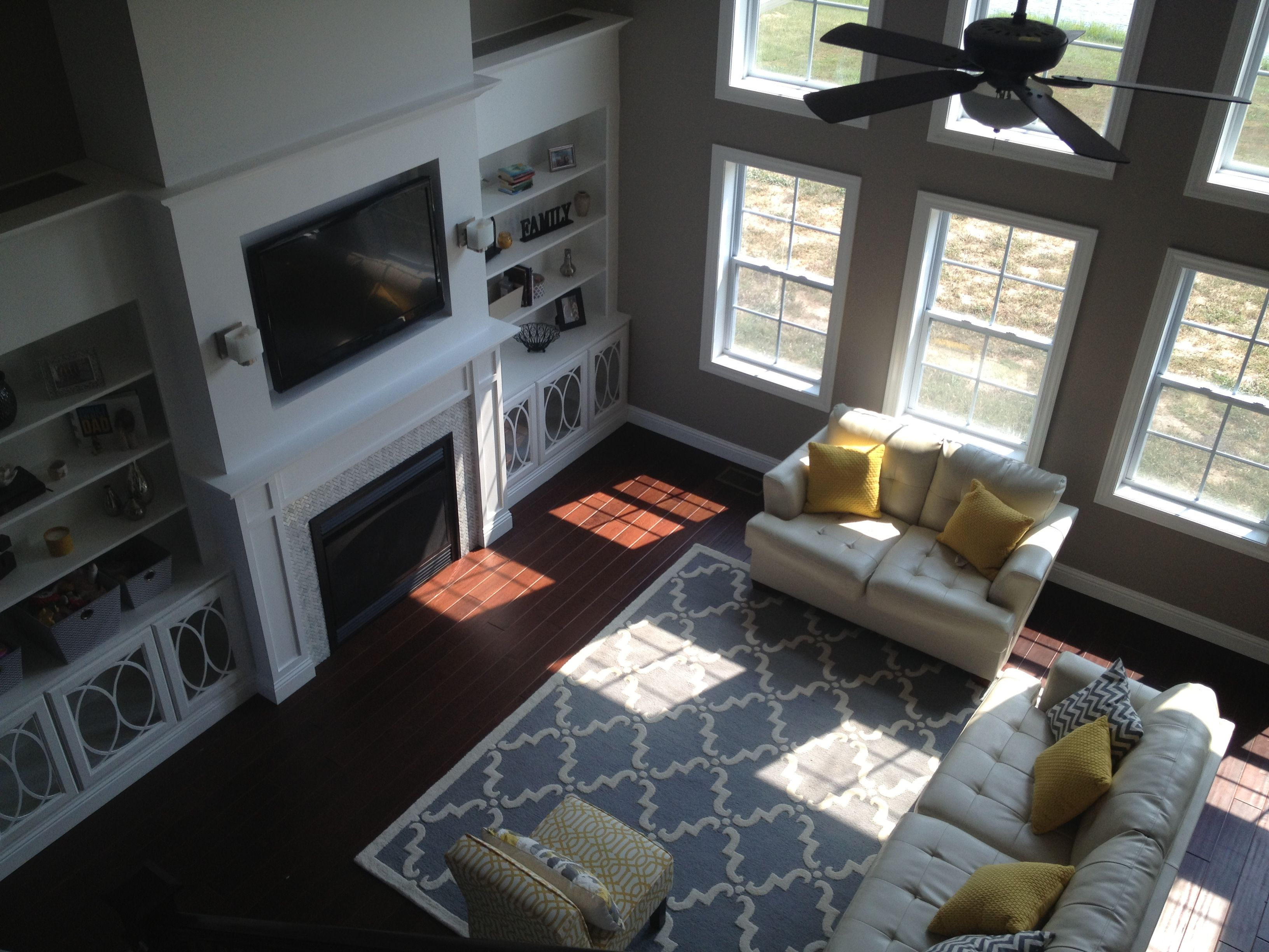 2 Story Living Room Yellow And Gray Built Ins Trellis Rug Our New Home Pinterest Living