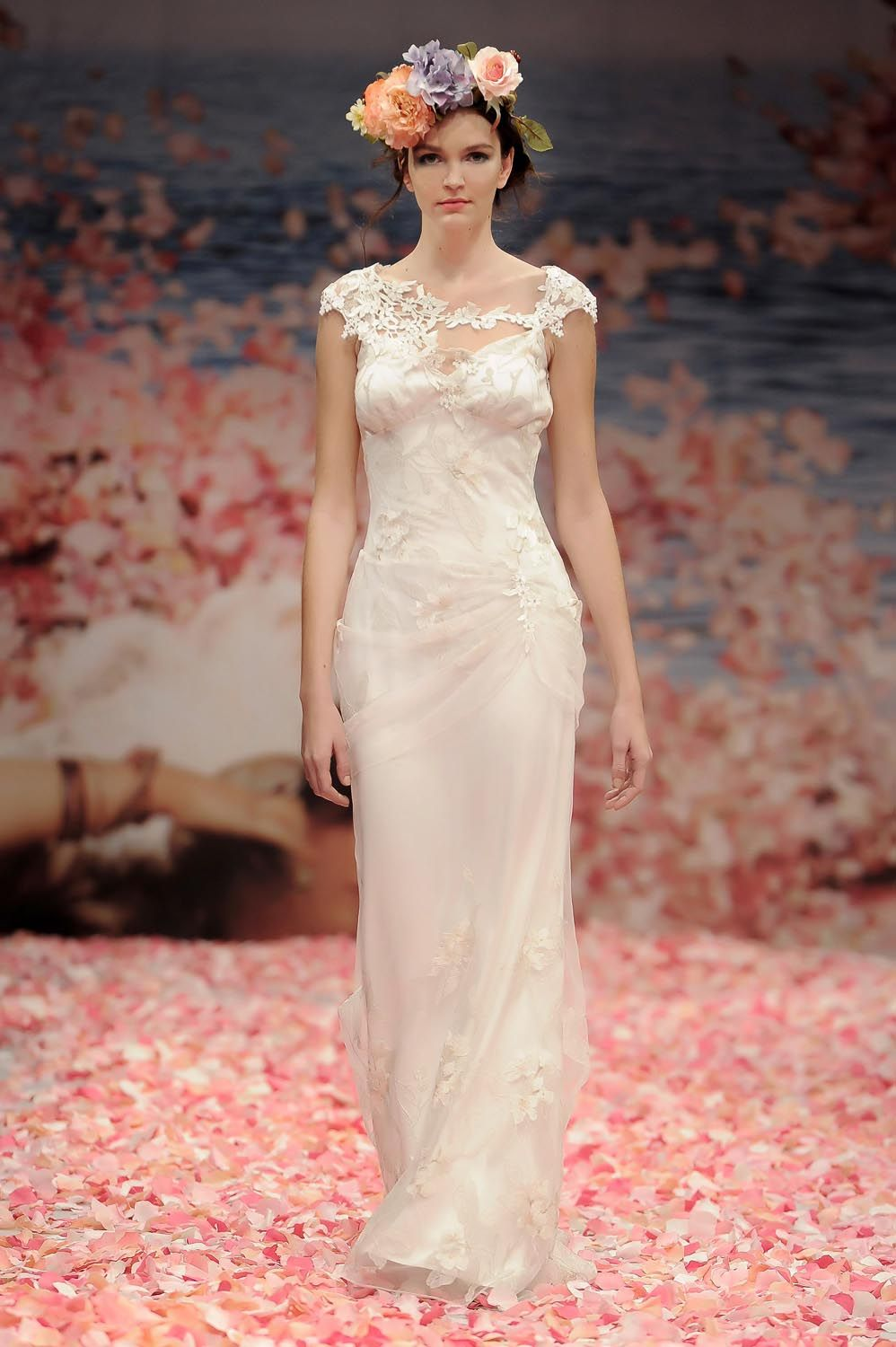 ADAGIO Wedding Gown by Claire Pettibone. Draped ivory olive branch embroidery with pearl silk and jeweled guipure vine embellishments.