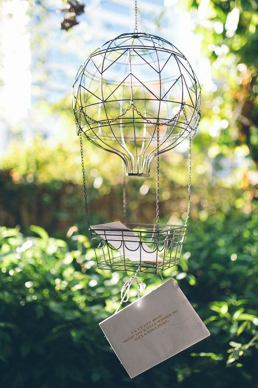 Guest book alternative: a whimsical hot air balloon to hold postcards from guests to the bride & groom | Photo by Daniel Lateulade via Floridian Weddings