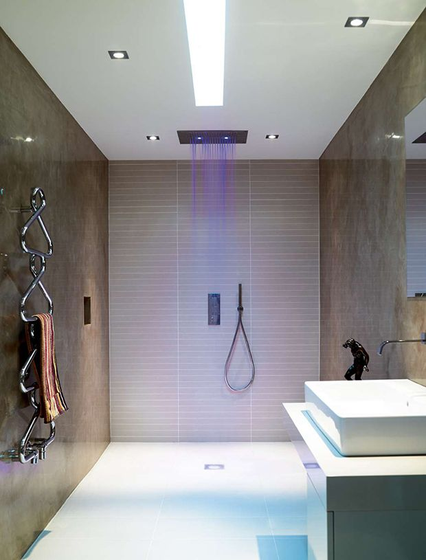 wet room with polished plaster walls and illuminated shower Home