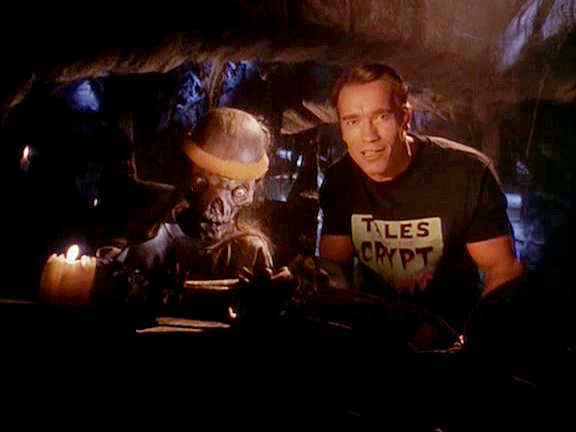The Crypt Keeper & Arnold Schwarzenegger in the episode 'The Switch' from Tales from the Crypt (1990)