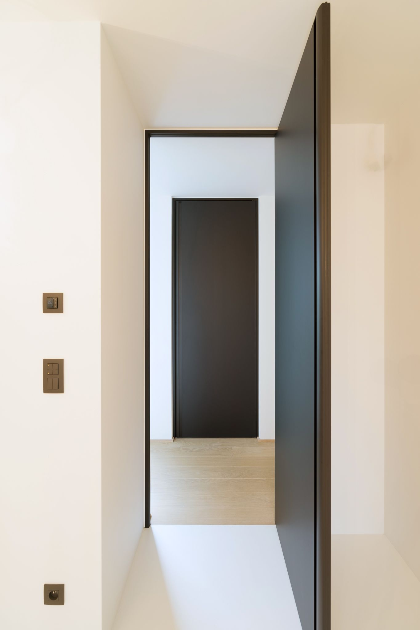 Exceptional Black Door From Floor To Ceiling With A Black Doorframe And Built In Handle.