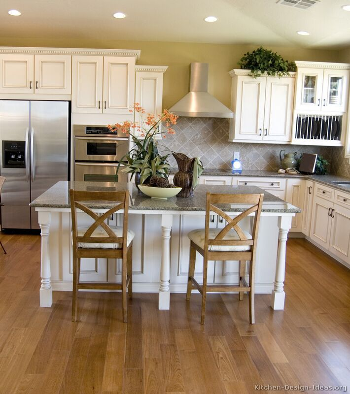 #Kitchen Of The Week: Traditional Design With Antique White Cabinets, Wood Floors, And A Kitchen