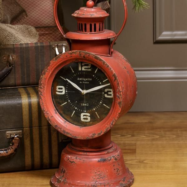 "19.5"" tall and 8"" wide.  Red painted railroad clock. Required one AA battery not included."