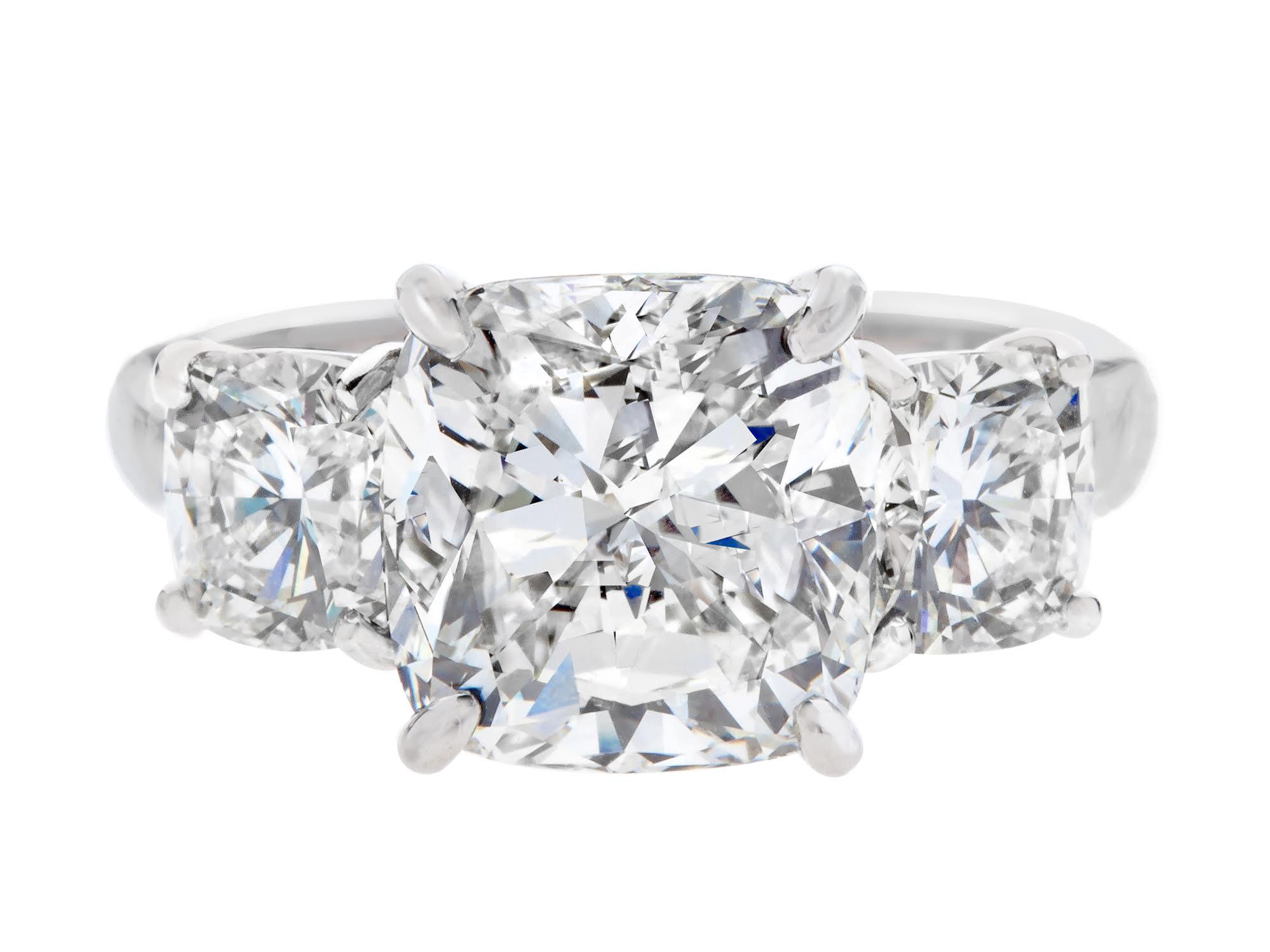 Gordon James 5.03 carat Cushion Cut 3 stone Diamond Ring; 7.09 carat total weight. Set in platinum. http://www.gordonjamesdiamonds.com/products/diamond-rings/tsr-841
