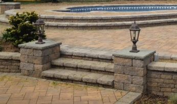 F&S Installation created these beautiful steps with Cambridge pavingstones and accented them with a Cambridge column kit.