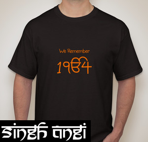 """From the """"We Remember"""" line this is our """"1984"""" shirt printed in orange on a black t-shirt the symbol in the design is a commonly known image for Sikhs, """"Ek Ong Kar"""" meaning One God"""
