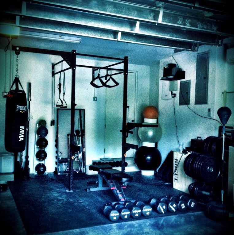 Ideal home garage gym rogue fitness weights squats boxing