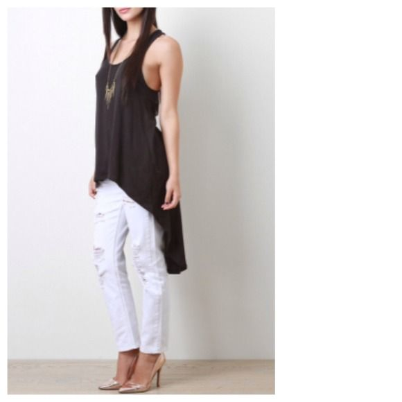 """CHIC Black Jersey Hi-Lo Tunic Tank Top LAST PIECE Who doesn't love a classic tank turned edgy???? Small measures 30""""-34"""" for Bust, 46"""" for Hips, 25"""" for Front Length and 40"""" for Back Length. Fabric is UBER soft and comfy being equal parts Cotton as well as Modal. Tops Tank Tops"""