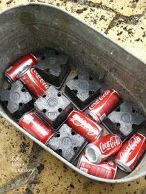 Plastic and empty [clean] cans in bottom of planter for drainage and minimizing amount of soil needed