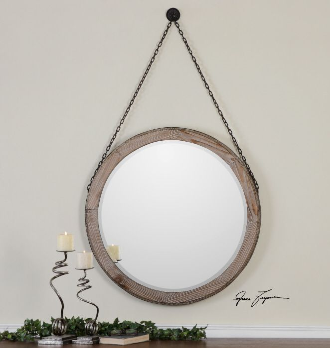 Uttermost Loughlin Mirror. Lightly stained wood frame surrounded by ...