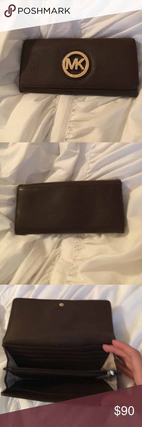 Michael Kors brown leather wallet Perfect condition, never used. Offers accepted and trades considered. Michael Kors Bags Wallets