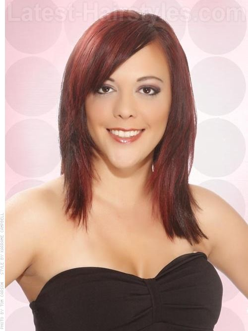Medium Length Haircuts For Oval Faces : Layered medium length hairstyle with red highlights hair
