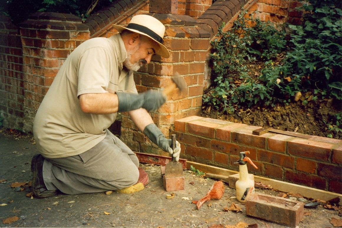 Chris building wall at Thornlea, 2000?