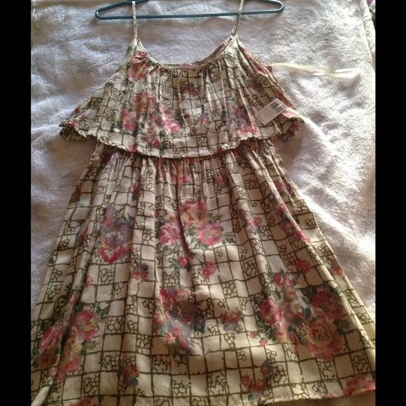 Wet Seal Floral Dress. New with tags floral pink & beige. Tag says Large but more like a Medium I am a Large and it does not fit me. Wet Seal Dresses