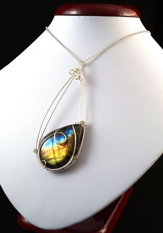 A delicate unique handmade wire wrapped pendant with labradorite a delicate unique handmade wire wrapped pendant with labradorite pendant was designed aloadofball Images