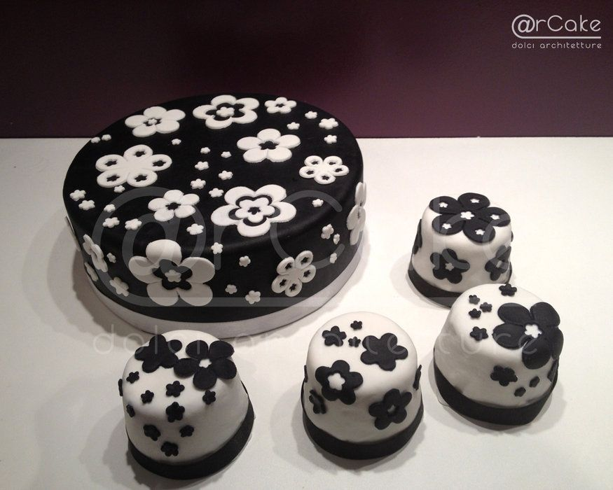 black and white with flowers cake and mini cakes. not to fancy and cute