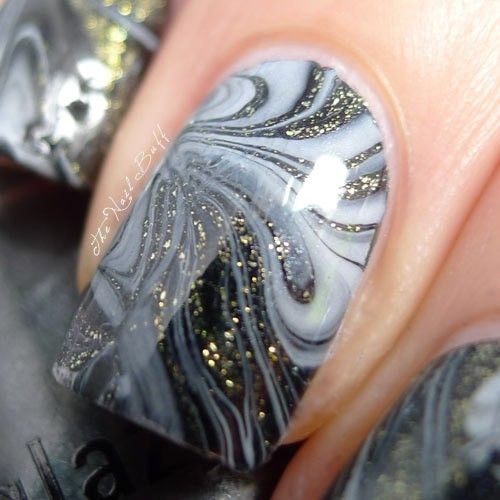 China Glaze White On White, China Glaze Black Diamond, China Glaze Whitecap and Models Own Black Swirl, over a coat of Nina Ultra Pro Black. The shimmery being seen here comes from the China Glaze White Cap.