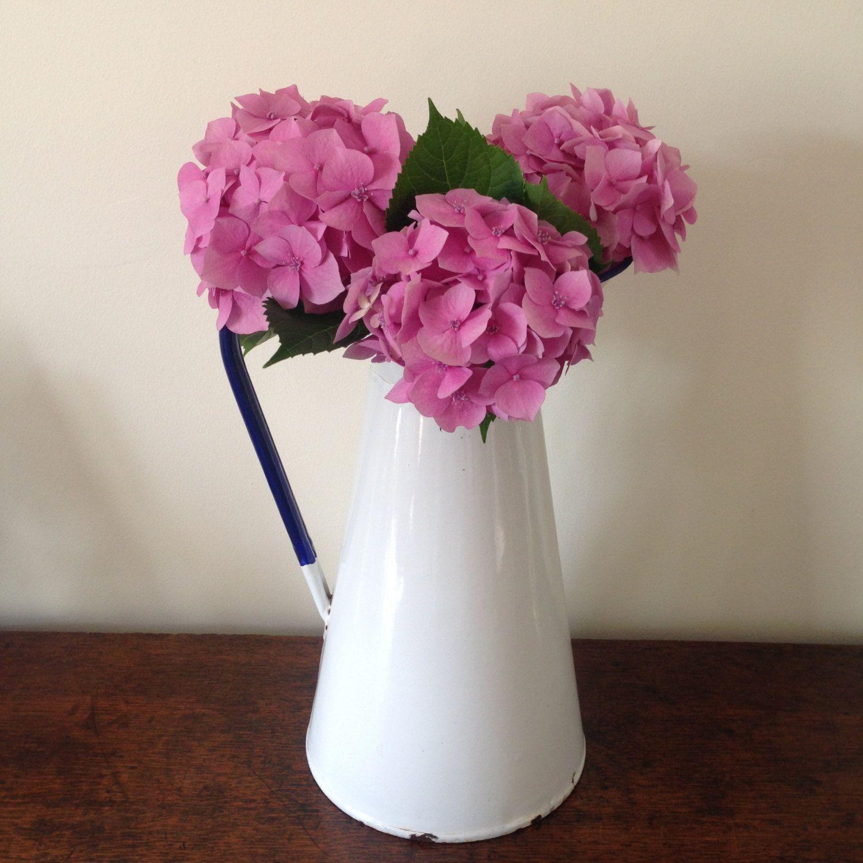 Vintage french enamel pitcherjug flower vase white with a blue vintage french enamel pitcherjug flower vase white with a blue rim by reviewsmspy