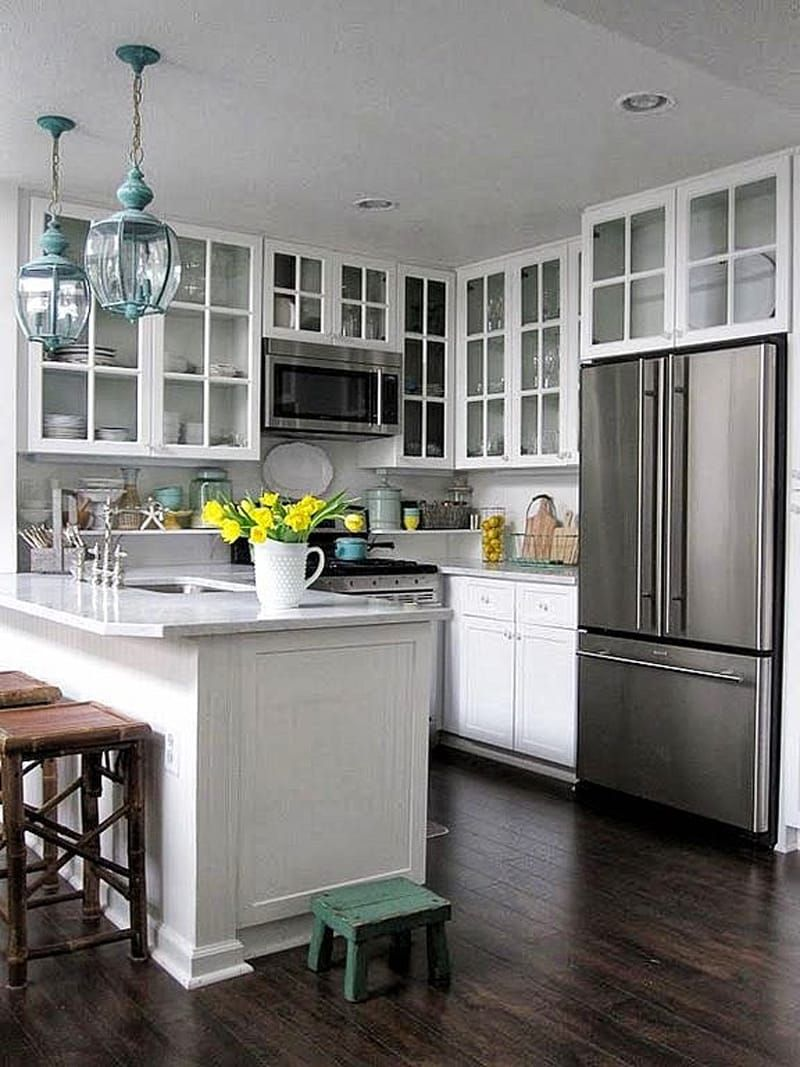 Glass Faced Upper Cabinets With White Interior Wall And White Marble Peninsula Countertop With Clipped Corner Kitchen Design Small Home Kitchens Kitchen Design