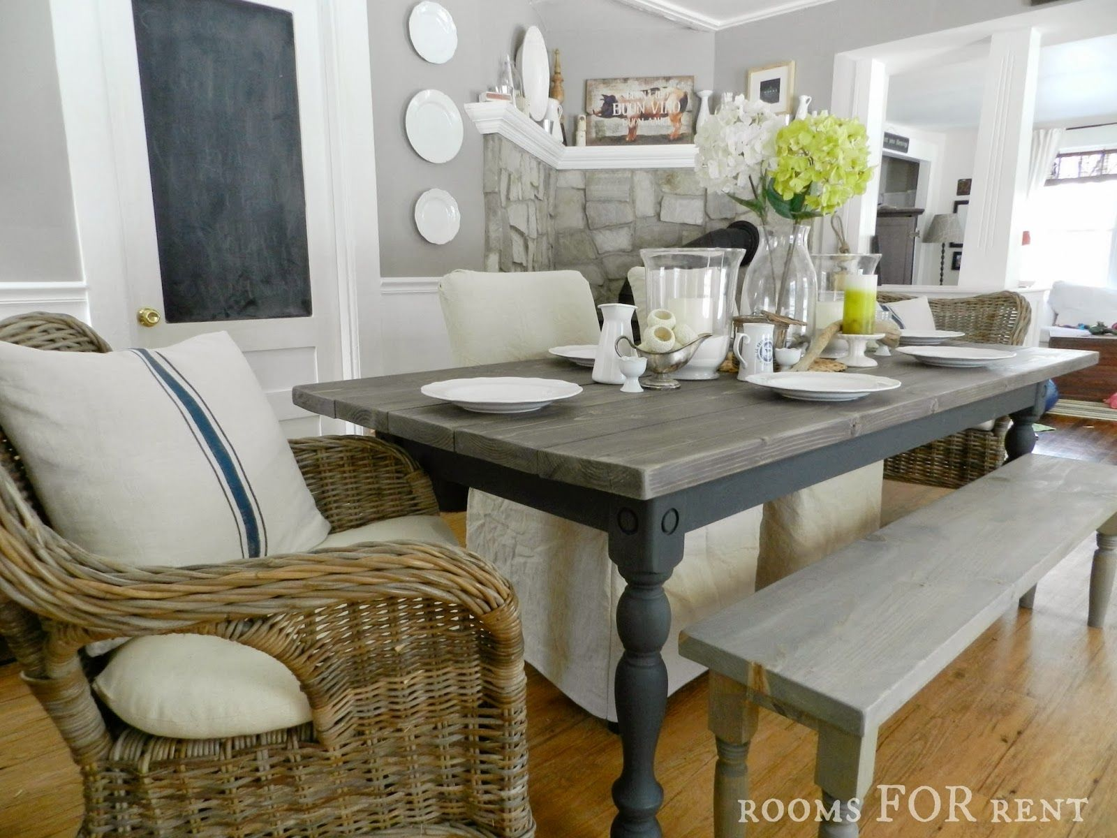 grey wood kitchen table rectangle with bench as graphite base and legs top has colored stain then