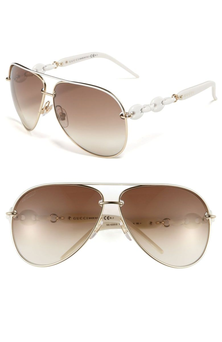 dda2bd97e5e Engraved logos and nautical chain links polish the arms of sleek aviator  sunglasses fitted with gradient lenses and comfort-fit ...