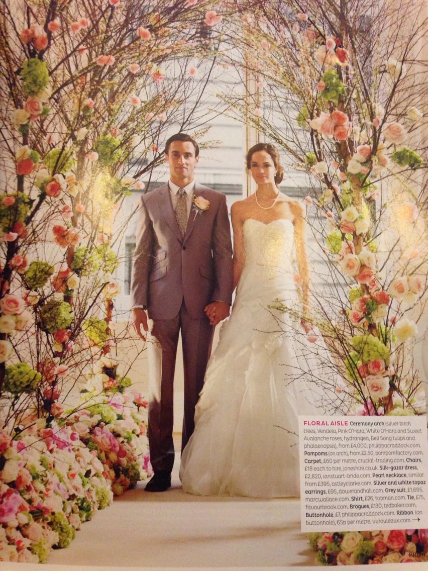 Floral ceremony arch    Featured in Brides