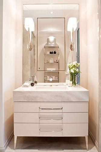 Guest bath perfect storage sleek finishes dresser for Modern powder room vanity