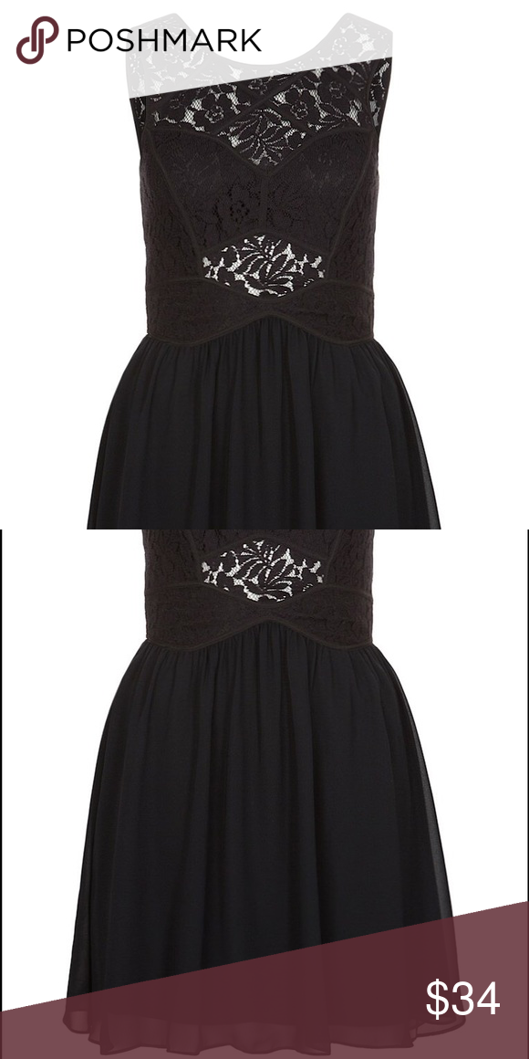BCBG black lace short dress Zipper in back. V-neck in back and high swoop in front. Some see through lace (small patch above belly button, patch at small of back, and above bra area). Dress length above knee. BCBGeneration Dresses