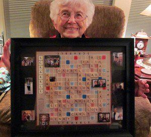 Cherished friends and family members are framed forever in this Scrabble game board collage.