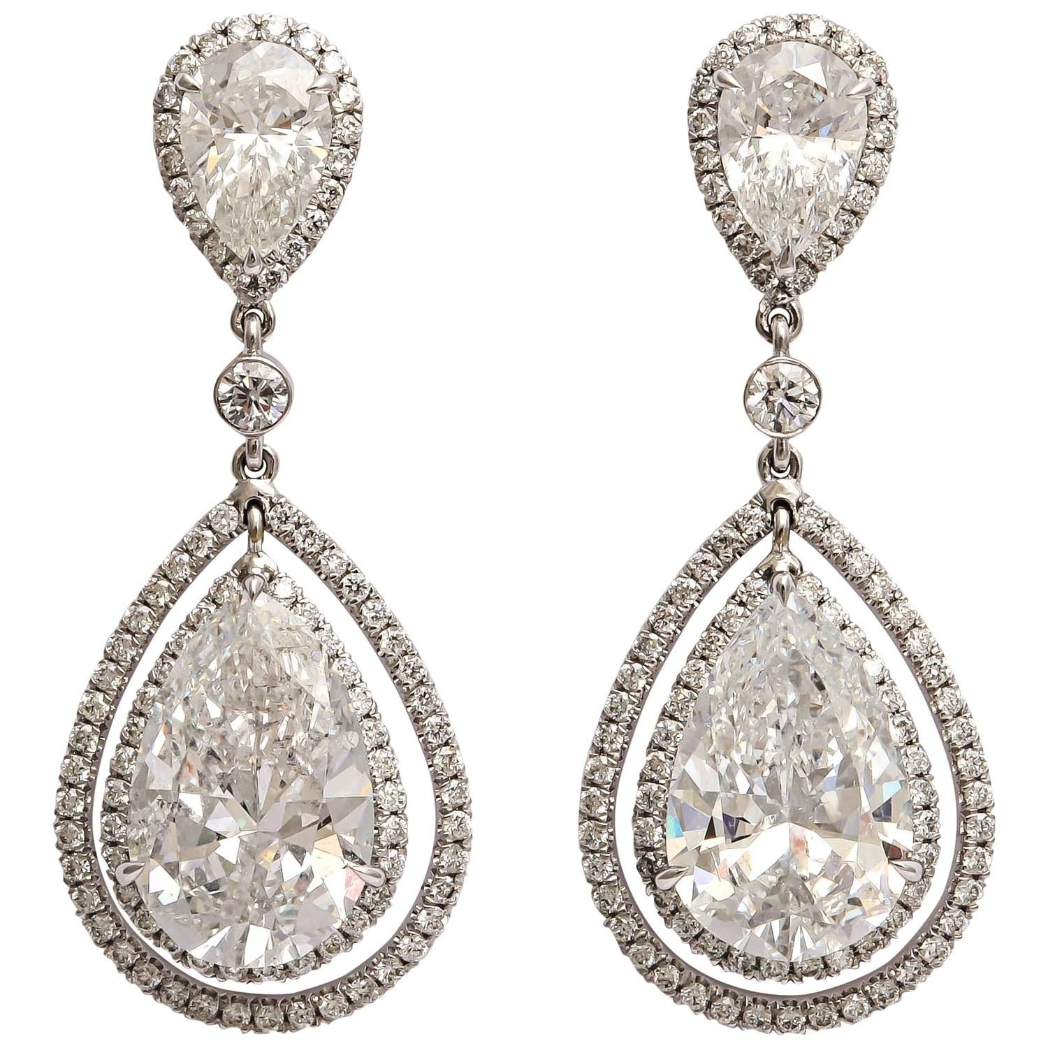Regal Pear Shaped Diamond Dangling Earrings