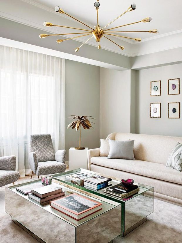 Living-Pink-Madrid-apt-glam-living-room-neutrals-mirrored-coffee-tables-brass-sputnik-lamp