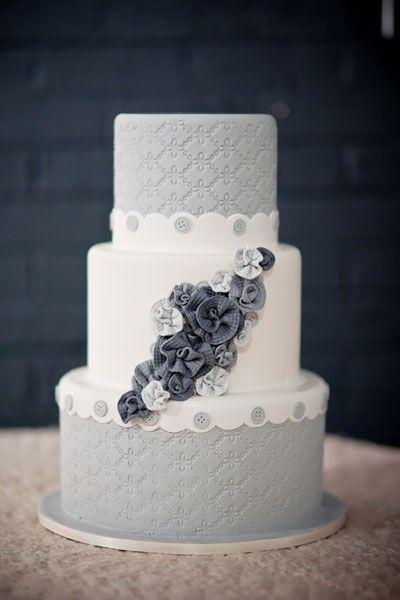Grey wedding cake with floral accents.