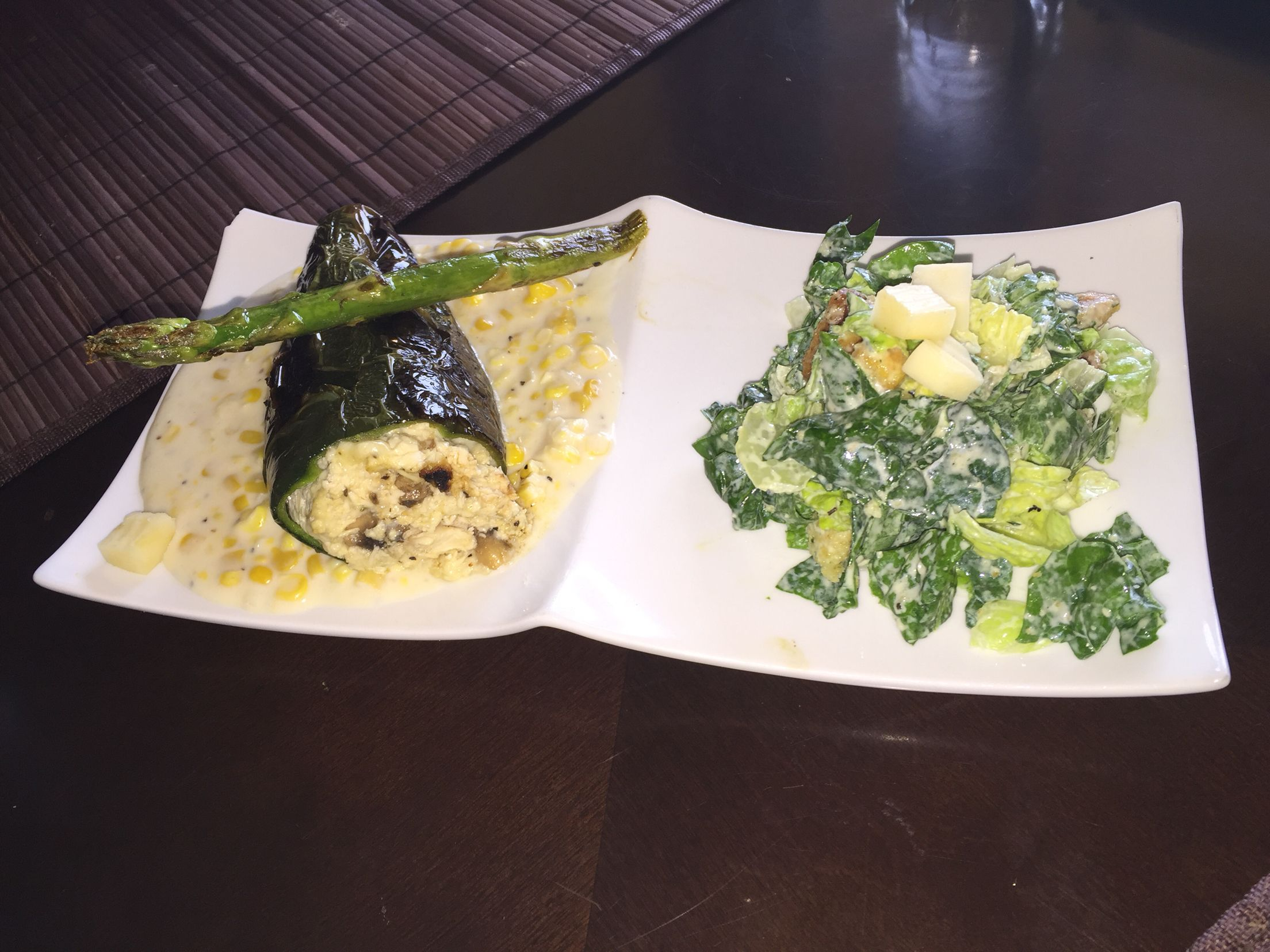 Poblano pepper stuffed with ck mush and manchego cheese!! On a bed of cream corn!