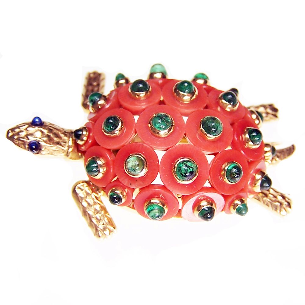 CARTIER CORAL TURTLE CLIP  A Cartier brooch in the form of a turtle with carved coral discs set with emerald cabochons as the shell. 18ct yellow gold.  Paris. Circa 1950.
