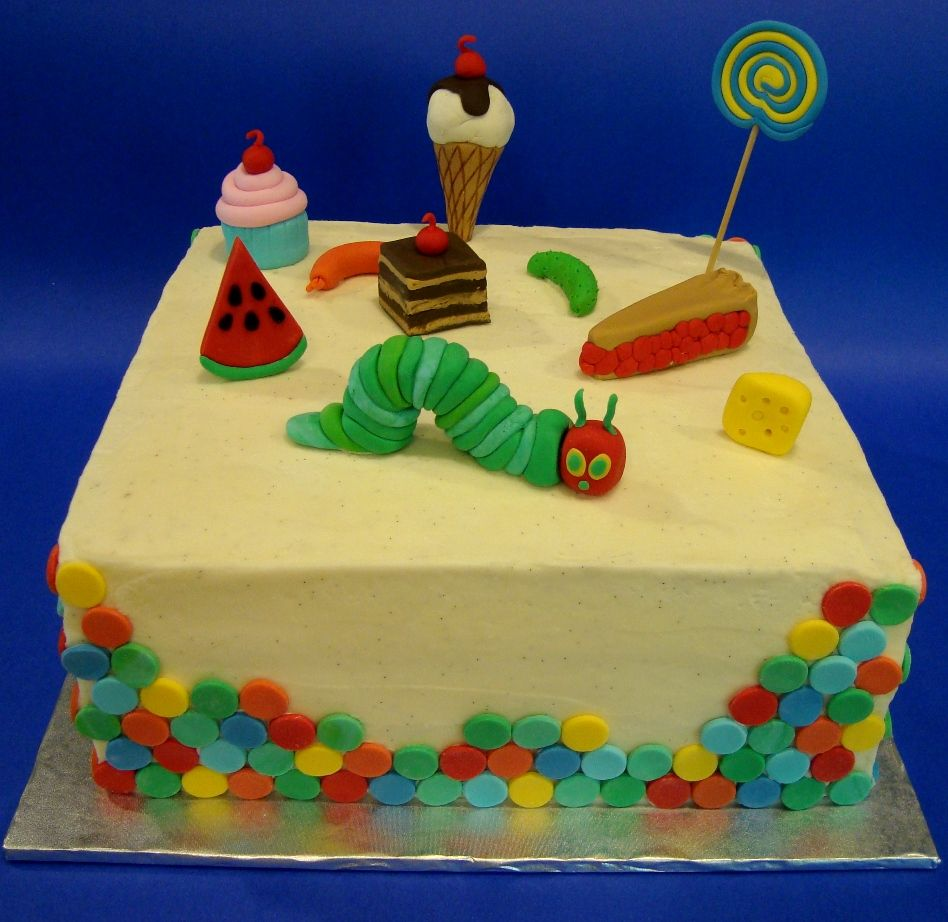 The Very Hungry Caterpillar - Chocolate cake covered in vanilla bean buttercream with fondant decorations inspired by Bella Cupcakes