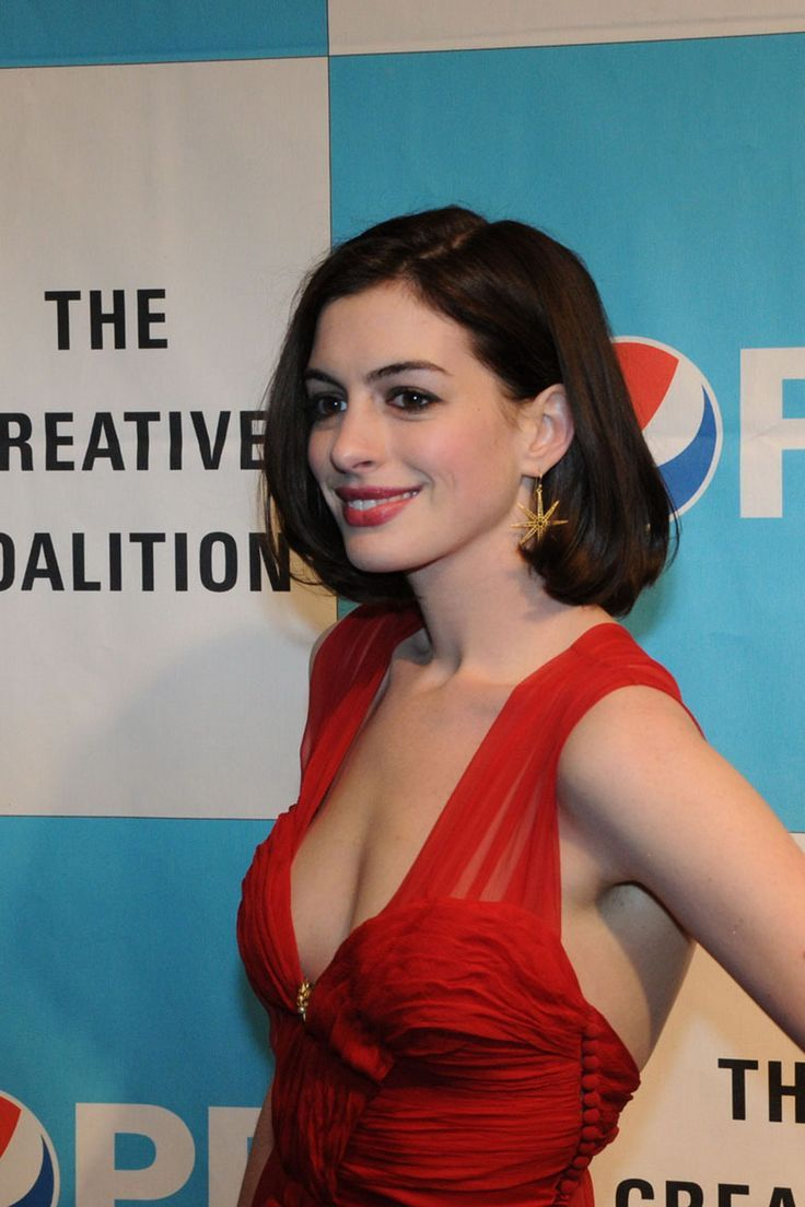 Anne hathaway red carpet casual with a brilliant smile and fire