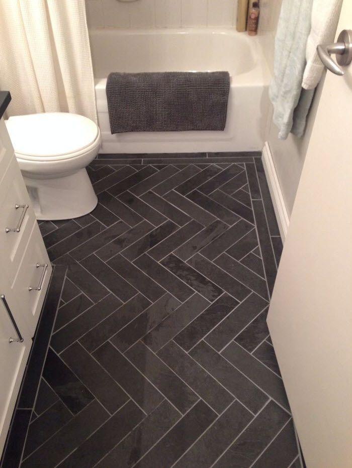 Charcoal Gray Herringbone Honed Marble Floors In The Bathroom