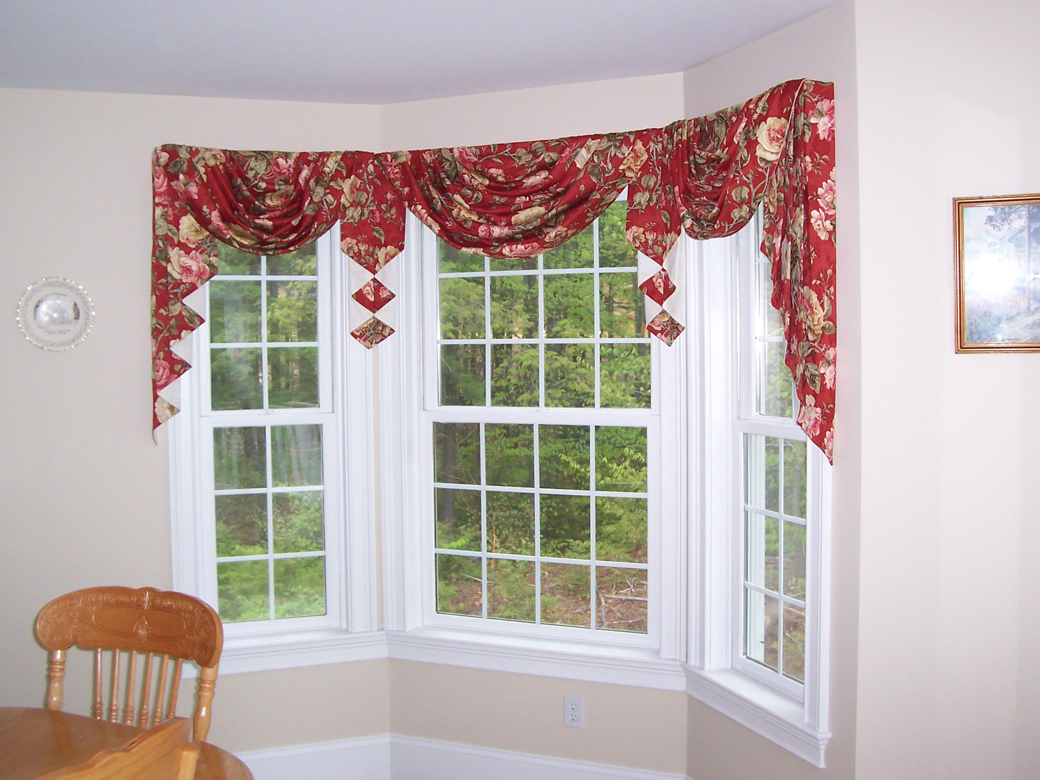 Tailored swag and jabots for a bay window bay window for Window treatments for bay windows in dining room
